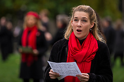 "© Licensed to London News Pictures. 30/10/2020. LONDON, UK.  An opera singer performs during ""Survival in the Square"", on day five of a week long series of creative activities taking place each day in Parliament Square.  The event is organised by #WeMakeEvents, an international movement to highlight that the live events sector urgently needs support from local governments to survive the Covid-19 crisis.  Photo credit: Stephen Chung/LNP"