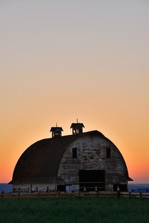 Sunset behind a barn in Southeastern Washington.