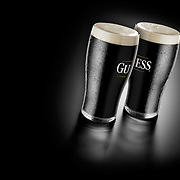 Two pints of Guinness shot in a creative way to make the viewer guess the iconic brand name. Shot in the Hype studio by photographer Stuart Freeman.