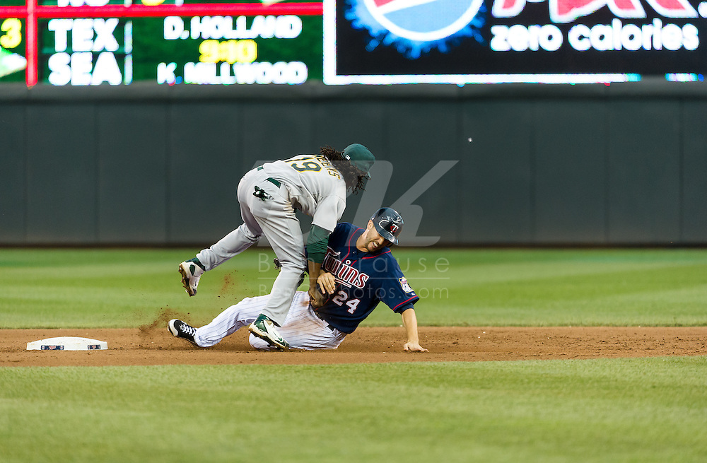Minnesota Twins 3rd baseman Trevor Plouffe is tagged out at 2nd base by Oakland Athletics 2nd baseman Jemile Weeks on July 13, 2012 at Target Field in Minneapolis, Minnesota.  The Athletics defeated the Twins 6 to 3.  © 2012 Ben Krause
