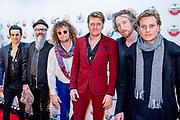 Rode loper bij  Vrienden van Amstel Live in Ahoy te Rotterdam.<br /> <br /> Op de foto:   Jamie Westland, Frans 'Spike' van Zoest, Bas van Wageningen, Paul Jan Bakker en Marcel Veenendaal , Di-Rect