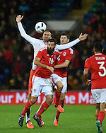 Joe Ledley of Wales gets to a header ahead of Bas Dost of the Netherland's. Vauxhall International football friendly, Wales v The Netherlands at the Cardiff city stadium in Cardiff, South Wales on Friday 13th November 2015. pic by Andrew Orchard, Andrew Orchard sports photography.