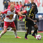 HARRISON, NEW JERSEY- OCTOBER 16:  Harrison Afful #25 of Columbus Crew is challenged by Mike Grella #13 of New York Red Bulls during the New York Red Bulls Vs Columbus Crew SC MLS regular season match at Red Bull Arena, on October 16, 2016 in Harrison, New Jersey. (Photo by Tim Clayton/Corbis via Getty Images)