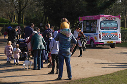 © Licensed to London News Pictures. 28/02/2021. Sheffield, UK.  Members of the public queue for an ice cream in Endcliffe Park, Sheffield, in mild spring weather .Photo credit: Ioannis Alexopoulos/LNP