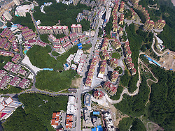 September 14, 2016 - Lichuan, Lichuan, China - Lichuan, CHINA-September 12 2016:?(EDITORIAL?USE?ONLY.?CHINA?OUT)..Empty buildings at a scenic area in Moudao Town, Lichuan,central China¡¯s Hubei Province. Although there are only about 30,000 residents living in Moudao Town, more than 100,000 apartments have been built in the Sumadang Scenic Area since 2010, which makes the small town a ¡®ghost town¡¯ in forest. (Credit Image: © SIPA Asia via ZUMA Wire)