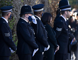 © Licensed to London News Pictures. 04/11/2020. Shoreham, UK. Police officers pay their respects as the funeral cortege carrying the coffin of police Sgt Matt Ratana leaves a funeral directors in Shoreham, West Sussex after a service was held. Family members were joined by police colleagues including Metropolitan Police Commissioner Cressida Dick. A traditonal Maori Haka was performed during the service. Sgt Ratana died from a gunshot wound to the chest in the early hours of September 25 at Croydon custody centre. Photo credit: Peter Macdiarmid/LNP