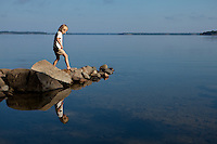 Little girl (Addy Budliger) playing on the shore of Burton Island, Lake Champlain, Vermont