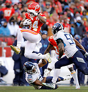 Kansas City Chiefs running back Darwin Thompson (34) hurdles Tennessee Titans cornerback Adoree' Jackson (25) as inside linebacker Jayon Brown (55) also defends during an NFL, AFC Championship football game against the Tennessee Titans, Sunday, Jan. 19, 2020, in Kansas City, MO. The Chiefs won 35-24 to advance to Super Bowl 54. (Colin E. Braley) Colin Eric Braley Photography