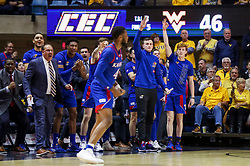 Feb 12, 2020; Morgantown, West Virginia, USA; The Kansas Jayhawks bench celebrates after a three pointer by Kansas Jayhawks guard Isaiah Moss (4) during the second half against the West Virginia Mountaineers at WVU Coliseum. Mandatory Credit: Ben Queen-USA TODAY Sports
