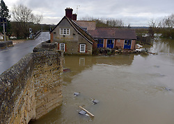 © Licensed to London News Pictures. 26/11/2012. Oxfordshire, UK The Maybush pub is surrounded by the floodwater from the River Thames in Witney, Newbridge. Flooding on the River Thames today 26th November 2012 in Oxfordshire. Photo credit : Stephen Simpson/LNP