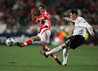Photo: Lee Earle.<br /> Benfica v Liverpool. UEFA Champions League. 2nd Round, 1st Leg. 21/02/2006. Liverpool's Steve Finnan (R) clears from Laurent Robert.