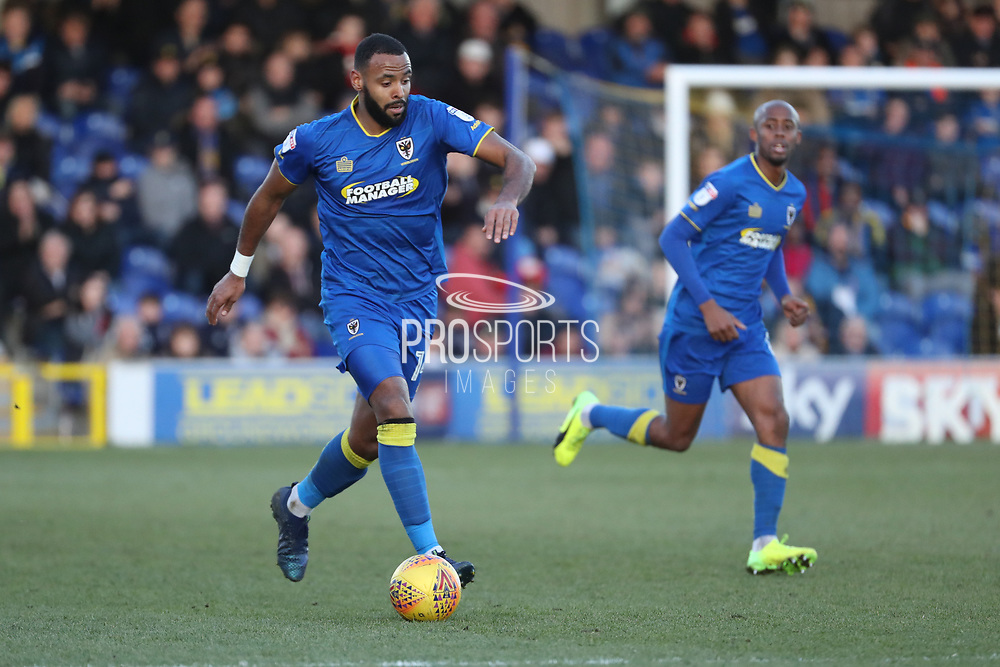 AFC Wimbledon midfielder Liam Trotter (14)  dribbling during the EFL Sky Bet League 1 match between AFC Wimbledon and Bristol Rovers at the Cherry Red Records Stadium, Kingston, England on 17 February 2018. Picture by Matthew Redman.