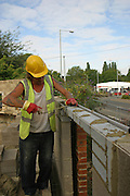 Brick layers at work on a new YMCA facility in Kettering, Northamptonshire