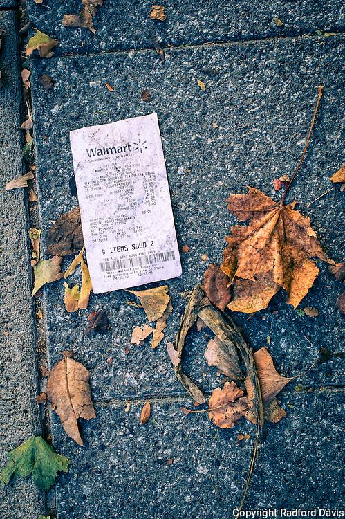 A consumer society. A Walmart receipt on the street.