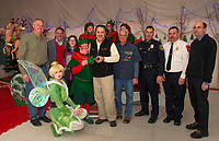 Mayor Ben Phillips receives the 2018 key to Christmas Village from Laconia Mayor Ed Engler as Christmas Village opens on Thursday evening. (l-r) Scott Myers, Tinkerbell, Henry and Bessie Lipman, Mayor Ben Phillips, Mayor Ed Engler, Bob Hamel, Matt Canfield, Kirk Beattie,Wes Anderson and Santa's elves.   (Karen Bobotas/for the Laconia Daily Sun)