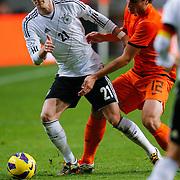 NLD/Amsterdam/20121114 - Vriendschappelijk duel Nederland - Duitsland, Marco Reus in duel met Daryl Janmaat