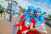 Emily Lowthian and Hannah Galletty (both 17 and from Aylesbury) come as Thing 1 and 2 from Doctor Zeus. They are best mates and studying performing arts - apparently their wardrobes are full of costumes which help with this. London Film and Comic Con 2014, (LFCC), at Earls Court, London, UK.