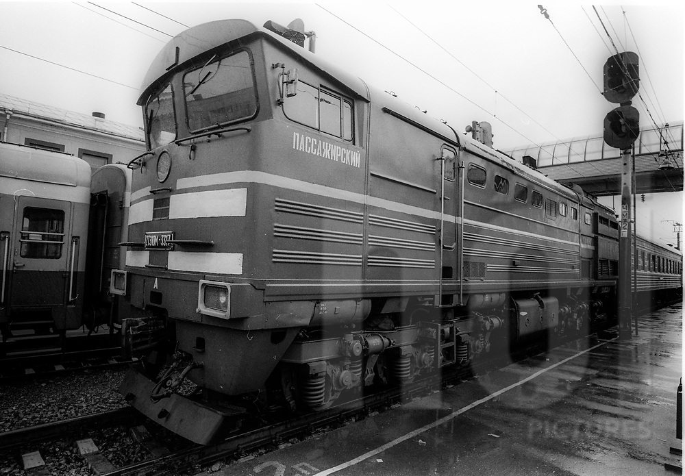 Old russian locomotive stationed in a train station, Russia