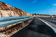 Safety metal guardrail on a rural roadside