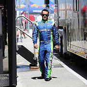 Driver Casey Mears is seen in the garage area during the NASCAR Coke Zero 400 Sprint practice session at the Daytona International Speedway on Thursday, July 4, 2013 in Daytona Beach, Florida.  (AP Photo/Alex Menendez)