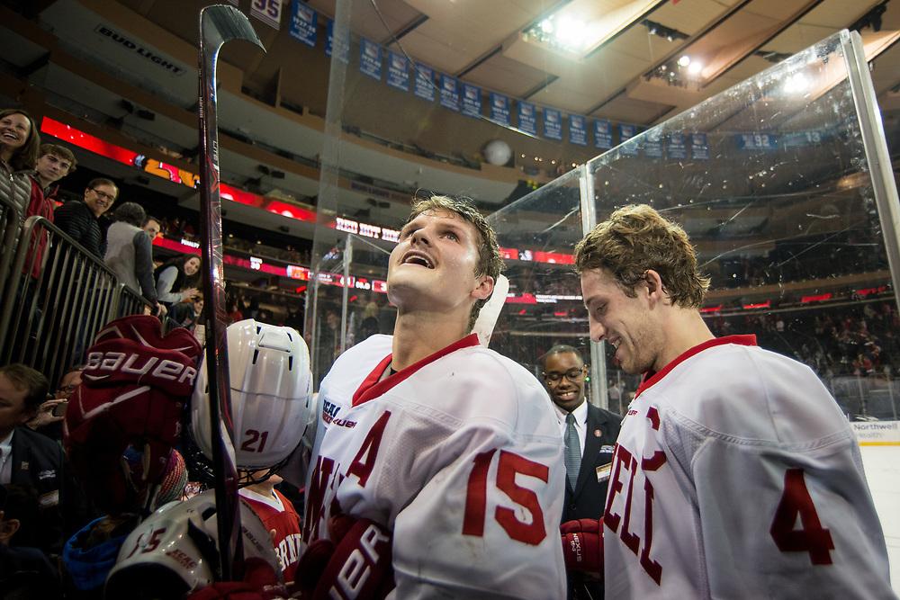 Cornell University forwards Trevor Yates and Alex Rauter greet fans after beating Boston University at Madison Square Garden in New York, New York on November 25 2017.