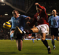 Photo: Javier Garcia/Digitalsport<br /> 07/11/2004 Manchester United v Manchester City, FA Barclays Premiership, Old Trafford<br /> Manchester City's Richard Dunne flies in to deny Christiano Ronaldo with a last ditch tackle