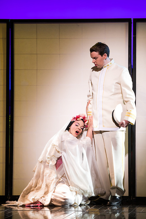 """LONDON, UK, 14 May, 2016. Rina Harms (left, as Butterfly) and David Butt Philip (right, as Pinkerton) rehearse for the revival of director Anthony Minghella's production of Puccini's opera """"Madam Butterfly"""" at the London Coliseum for the English National Opera. The production opens on 16 May. Photo credit: Scott Rylander."""