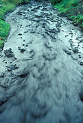 Fast Flooding River, Banos, Ecuador, caused by desforestation of highland areas and eroding away of soil, in high rains, moving, flowing, evironmental