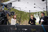 UK. London. The Village Green: From Blair to Brexit.<br /> A story on the relationship between the Media, Politicians and the public as they come together on College Green, a small patch of land next to The Houses of Parliament in Westminster. <br /> Photo shows Caroline Lucas, Britain's first Green MP, being interviewed by Sky News on the Green five days after a General Election returned a new coalition Government formed of the Conservatives and Liberal Democrats. <br /> Photo©Steve Forrest/Workers' Photos