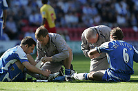 Photo: Andi Thompson.<br />Wigan Athletic v Watford. The Barclays Premiership. 23/09/2006.<br />Wigan's Arjan De Zeeuw (R) and Leighton Baines (L)go down injured