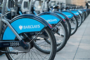 "Canary Wharf. The financial district. London. ""Boris Bikes"" sponsored by Barclays available for hire. London, UK."