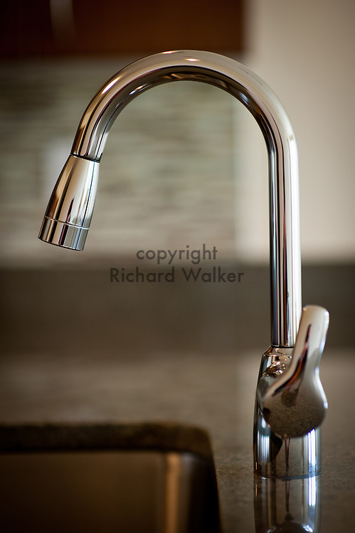 2012 May 29 - Kitchen faucet in an apartment, Seattle, WA. CREDIT: Richard Walker