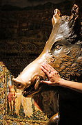 Hands touching Fontana del Porcellino (the bronze boar) for good luck at Mercato Nouvo, Florence, Tuscany, Italy