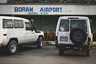 A woman uses her smart phone in the back of a Toyota landcruiser while waiting for an arriving flight at the airport in Wewak, Papua New Guinea. The Wewak Airport is also known as Boram Airport.<br /><br />(July 21, 2017)