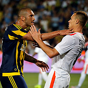 Fenerbahce's Fernandão (L) and Shakhtar Donetsk's Shevchuk (R)  during their UEFA Champions league third qualifying round first leg soccer match Fenerbahce between Shakhtar Donetsk at the Sukru Saracaoglu stadium in Istanbul Turkey on Tuesday 28 July 2015. Photo by Aykut AKICI/TURKPIX