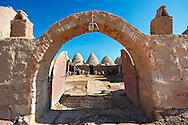 """Pictures of the beehive adobe buildings of Harran, south west Anatolia, Turkey.  Harran was a major ancient city in Upper Mesopotamia whose site is near the modern village of Altınbaşak, Turkey, 24 miles (44 kilometers) southeast of Şanlıurfa. The location is in a district of Şanlıurfa Province that is also named """"Harran"""". Harran is famous for its traditional 'beehive' adobe houses, constructed entirely without wood. The design of these makes them cool inside. 10 .<br /> <br /> If you prefer to buy from our ALAMY PHOTO LIBRARY  Collection visit : https://www.alamy.com/portfolio/paul-williams-funkystock/harran.html<br /> <br /> Visit our TURKEY PHOTO COLLECTIONS for more photos to download or buy as wall art prints https://funkystock.photoshelter.com/gallery-collection/3f-Pictures-of-Turkey-Turkey-Photos-Images-Fotos/C0000U.hJWkZxAbg ."""