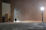 Middletown, NY - A solitary man walks through the downtown streets as snow falls during a winter storm on Dec. 19, 2008.