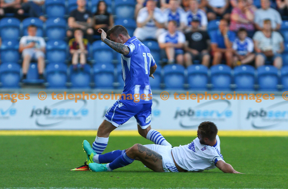 Like Chambers (white) of Ipswich Town slides in two footed during the Friendly match between Colchester United and Ipswich Town at the Weston Homes Community Stadium in Colchester. July 20, 2016.<br /> Arron Gent / Telephoto Images<br /> +44 7967 642437