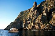 ECUADOR, GALAPAGOS volcanic cliffs on Wolf Island