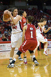 20 November 2010: Emily Hanley protects a ball from Melia Duncan during an NCAA Womens basketball game between the Southern Illinois-Edwardsville Cougars and the Illinois State Redbirds at Redbird Arena in Normal Illinois.