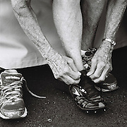 Slug: MASTERS<br /> Assignment ID: 30177851A<br /> Desk: SPT<br /> Date: 8/4/2015<br /> <br /> Flo Meiler, 81, of Shelburne, Vermont, puts on her racing spikes for the 80 meter hurdles before the start of competition on the first day of the 80-84 age division women's combined events, or heptathlon, on August 4, 2015 at the Laurent Gérin stadium in Venissieux, France during the 2015 World Masters Athletics Championships. <br /> <br /> The Championships, which include track & field events (as well as race walking, marathon, cross country, half marathon and combined events) contested by athletes of 35 ages and over divided into 5-year age divisions, are being held at multiple locations in Lyon, France from August 4 through 16, 2015. <br /> <br /> The first day of heptathlon competition includes the 80 meter hurdles, high jump, shot put and the 200 meters. Combined events are scored using an international point table, and masters scores are age-graded so they are comparable across age ranges. <br /> <br /> Meiler's score of 5730 broke the published existing world record of 4623 points in the W80 division, set by Johnnye Valien of California. Meiler's score still needs to be ratified to be official. <br /> <br /> Meiler and Cristel Donley, 80, of Colorado Springs, Colorado were the only competitors in their age division. They were also the oldest competitors in their event.<br /> <br /> photo by Angela Jimenez for The New York Times<br /> photographer contact 917-586-0916
