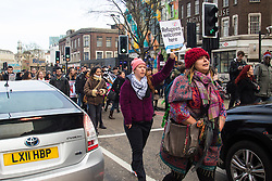 """St Pancras, London, January 16th 2016. Dozens of protesters hold an """"emergency demonstration and die-in"""" as France prepares to bulldoze the Jungle Camp at Calais. PICTURED: Protesters march through the traffic on the Euston Road. ///FOR LICENCING CONTACT: paul@pauldaveycreative.co.uk TEL:+44 (0) 7966 016 296 or +44 (0) 20 8969 6875. ©2016 Paul R Davey. All rights reserved."""