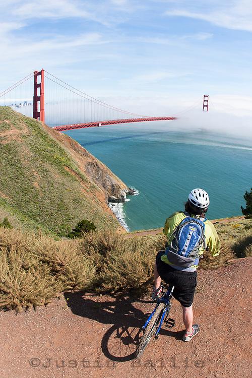 Young man mountain biking the Marin Headlands, Golden Gate National Recreation Area. San Francisco,  CA