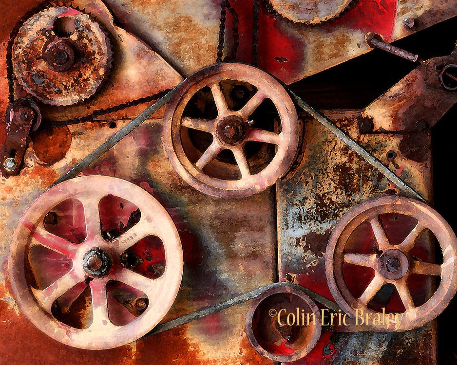 Gears and wheels of an old hay bailer. Arizona, 2008