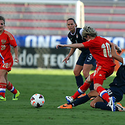 U.S. defender Stephanie Cox (14) tackles Russia forward Elena Terekhova (10) during an international friendly soccer match between the United States Women's National soccer team and the Russia National soccer team at FAU Stadium on Saturday, February 8, in Boca Raton, Florida. The U.S. won the match by a score of 7-0. (AP Photo/Alex Menendez)