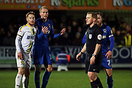 AFC Wimbledon midfielder Mitchell (Mitch) Pinnock (11) talking to ref and appealing for penalty during the EFL Sky Bet League 1 match between AFC Wimbledon and Burton Albion at the Cherry Red Records Stadium, Kingston, England on 28 January 2020.