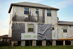 20 August 2015. New Orleans, Louisiana. <br /> Hurricane Katrina revisited. <br /> A decade later and recovery remains largely elusive for the area hardest hit by Katrina. A partially built house appears to have been  abandoned half way through construction.<br /> Photo credit©; Charlie Varley/varleypix.com.