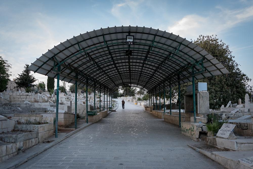 4 October 2018, Jerusalem: A man walks through the Yeusefiya cemetery.