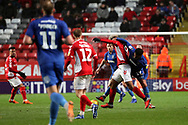 Charlton Athletic attacker Lyle Taylor (9) battles for possession with AFC Wimbledon midfielder Tom Soares (19) during the EFL Sky Bet League 1 match between Charlton Athletic and AFC Wimbledon at The Valley, London, England on 15 December 2018.