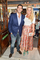 Singer NATALIE COYLE and her husband ZAFAR RUSHDIE at a Gala Performance of Impossible at the Noël Coward Theatre, 85-88 Saint Martin's Lane, London on 13th July 2016.